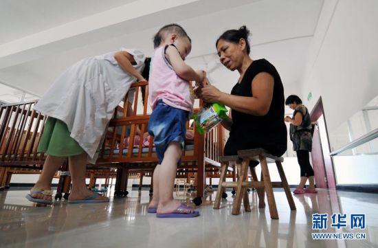 许月华:130个孩子的妈妈。