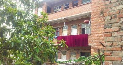 重庆市沙坪坝区井口镇二塘村周克华家的房子。 记者 戴鹏 摄