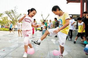 近年来,长沙市民的幸福指数不断攀升。瞧,这些小朋友在社区组织的活动中玩得多开心!  陈飞 摄