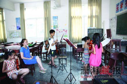 乾州区乾城小学内,暑期钢琴培训班。